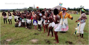 xhosa girls perfoming traditional Xhosa dances - Khaya La Bantu cultural village with old women behind