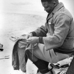 1964 Nelson Mandela sews prison clothes by the shore He was sent to the infamous jail at Robben Island 150x150 Nelson Mandela Timeline – Little Known Facts You May Not Know About Dalibhunga