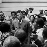1968 Nelson Mandela center stands amid a gathering of other co defendants during the Treason Trial 150x150 Nelson Mandela Timeline – Little Known Facts You May Not Know About Dalibhunga