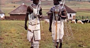 Xhosa-men-in-tradional-clothing-talking-in-a-village-mountains-behind - Xhosa History