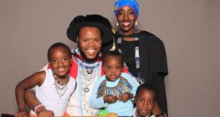 Dr Hlezi Kunju, who wrote his Rhodes University PhD in isiXhosa, with his family